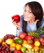 girl with fruit for raw foods diet